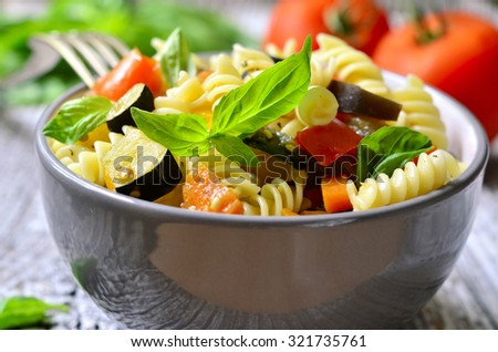 Ratatouille pasta in a bowl on wooden table. - stock photo