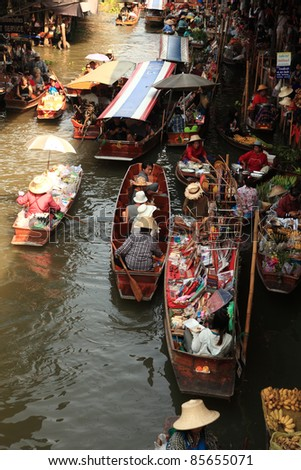 RATCHABURI, THAILAND - FEB 13: Boats ferry people at Damnoen Saduak floating market on February 13, 2011 in Ratchaburi, Thailand. Its famous for the  traditional and old method of selling and buying. - stock photo