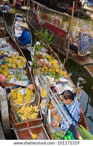 RATCHABURI, THAILAND - NOV 30: Boats ferry people at Damnoen Saduak floating market on November 30, 2011 in Ratchaburi, Thailand. Its famous for the traditional and old method of selling and buying. - stock photo
