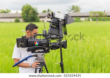 RATCHABURI, THAILAND - OCTOBER 5, 2015 :TV cameraman filmed news event out of place in Thailand. - stock photo