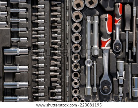 Ratchet spanners in car toolbox closeup photo - stock photo