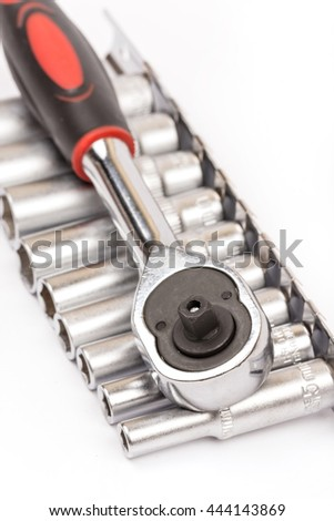 Ratchet with sockets over white background