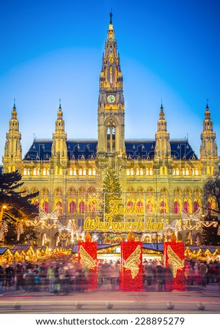 Rathaus and christmas market in Vienna, Austria Translation: Merry Christmas - stock photo