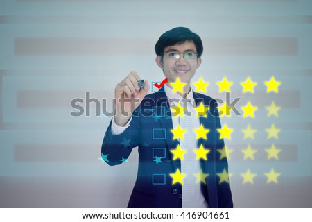 RATING concept presented by  businessman drawing on  virtual  screen  - stock photo