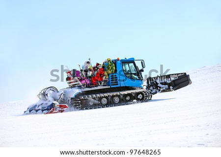 Ratrack taking skiers to top of mountain - stock photo