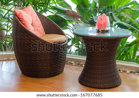 Rattan armchair furniture. Interior of a living room. - stock photo