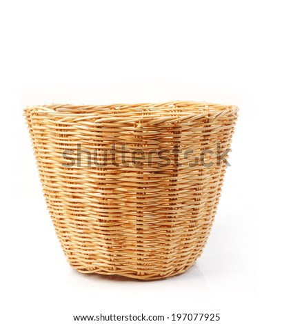 Rattan basket isolated over white background - stock photo