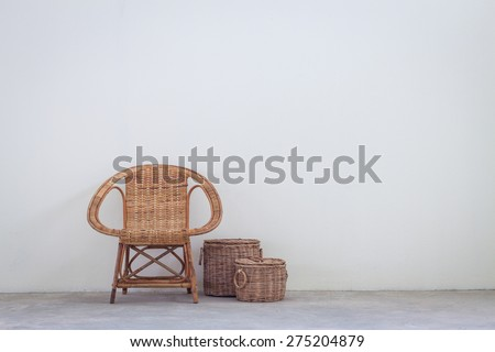 Rattan chair and furniture on concrete floor, interior decoration concept