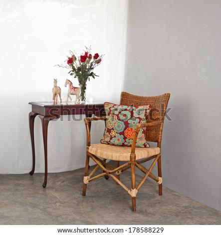 Rattan sofa chair in a patio garden lounge setting - stock photo