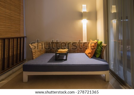 Rattan Sofa in terrace at night time - stock photo