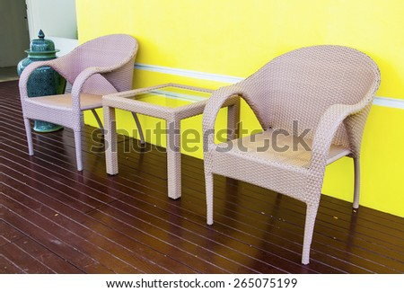 Rattans table and chairs set on terrace at home - stock photo