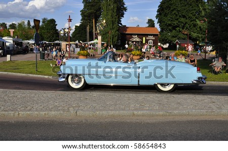 RATTVIK, SWEDEN - AUGUST 7: Participant of the classic car parade, August 7, 2010 in Rattvik - stock photo