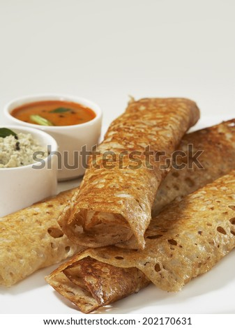 Rava dosa in plate, South Indian snack, India - stock photo