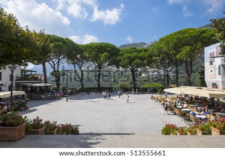 Ravello,Italy - September 30, 2016: Ravello's main square viewed from its church Duomo, a space surrounded by buildings, cafes, shops, and umbrella trees.