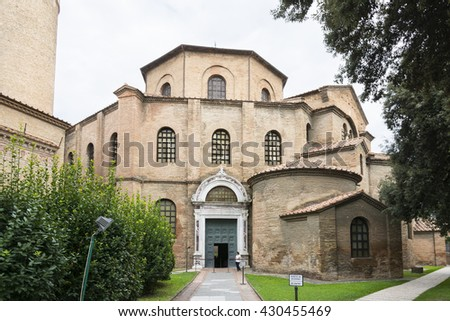 RAVENNA,ITALY-AUGUST 21,2015:people stroll in front the entrance of the San Vitale basilica in Ravenna-Italy,during a cloudy day .