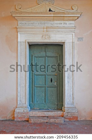 RAVENNA, ITALY- FEBRUARY 9, 2014: the old Saint Spirit Basilica door. The city defined by UNESCO heritage of humanity has 3 million tourists per year