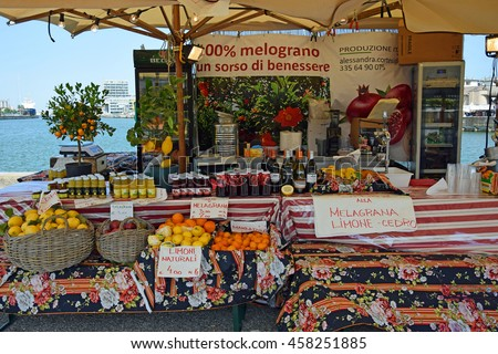 RAVENNA, ITALY-MAY 28, 2016: pomegranate stand at the old peer outdoor market. This market is very popular and attract thousands of tourists. - stock photo