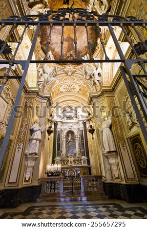RAVENNA, ITALY -?? SEPTEMBER 6, 2014: Detail of the chapel in lavish Baroque decorations on the left aisle of the Basilica of Saint Apollinare Nuovo in Ravenna, Italy  - stock photo