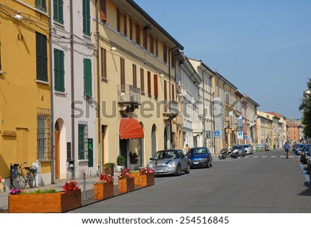 RAVENNA, ITALY â??SEPTEMBER 12, 2014: tourists and locals in a typical downtown street. The city defined by UNESCO heritage of humanity has 3 million tourists per year - stock photo