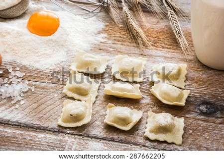 Ravioli  and other products on wooden table - stock photo