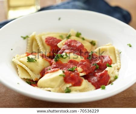 Ravioli in tomato sauce at dinner. - stock photo