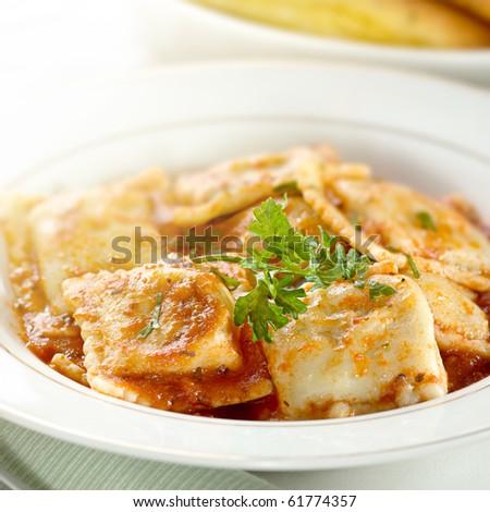 ravioli in tomato sauce with parsley  garnish - stock photo