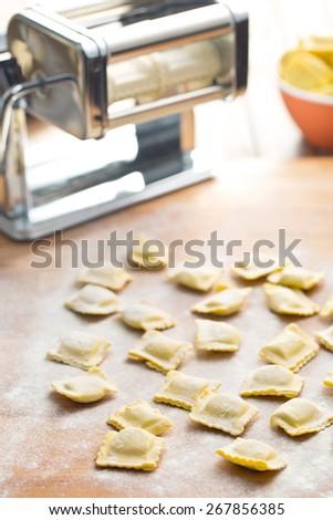 ravioli pasta on kitchen table - stock photo