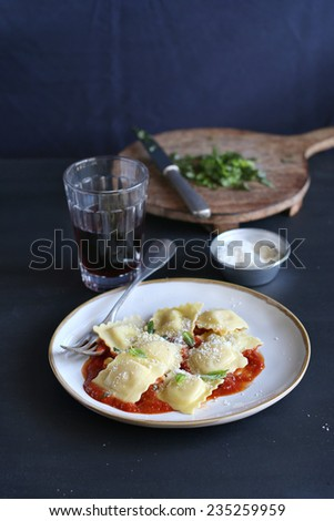 Ravioli pasta with tomato sauce - stock photo