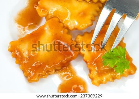 Ravioli with fork - stock photo