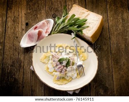 ravioli with ham, sage and cream sauce - stock photo