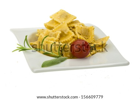 Ravioli with herbs isolated on white - stock photo