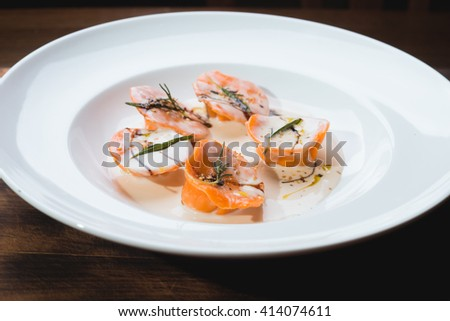 ravioli with mushrooms and rosemary, on a plate - stock photo