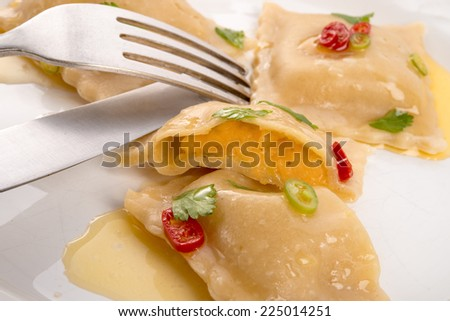 Ravioli with spicy butternut pumpkin filling - stock photo