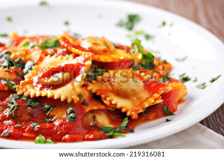 Ravioli with tomato sauce - stock photo