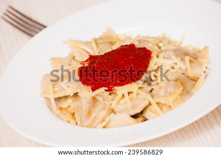 ravioli with tomato sauce and cheese - stock photo