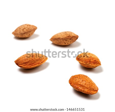 Raw almonds isolated on white background. Selective focus - stock photo