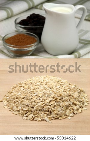 raw and healthy oat flakes with  raisins and other oatmeal ingredients that are  important on your daily nutrition to prevent high colesterol and heart dideases - stock photo