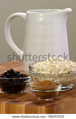 raw and healthy oat flakes with  raisins and other oatmeal ingredients that are  important on your daily nutrition to prevent high cholesterol and heart dideases - stock photo