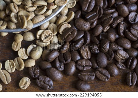 Raw and roasted coffee grains close up - stock photo