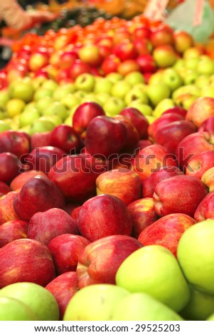 raw apple heaps perspective on market show tray - stock photo