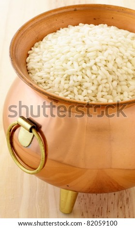 raw arborio rice used to make risotto, one of the most famous and delicious  Italian dishes - stock photo