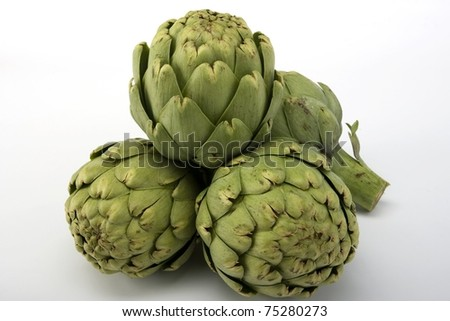 Raw artichokes on white background