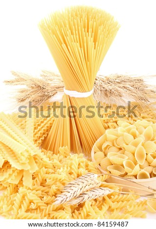 raw assortment of pasta on white background