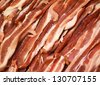 Raw bacon background - stock photo