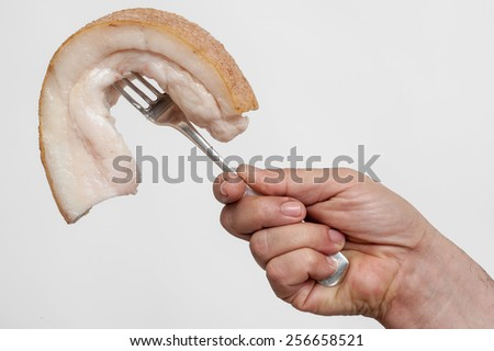 raw bacon on  a fork  - stock photo