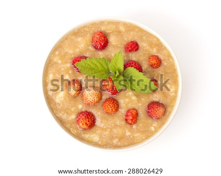 raw banana pudding with strawberries on a white background - stock photo
