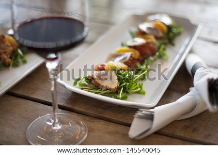 Raw beef appetizer with garnish with wine - stock photo