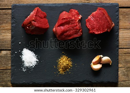 Raw beef filet mignon meat over slate - stock photo