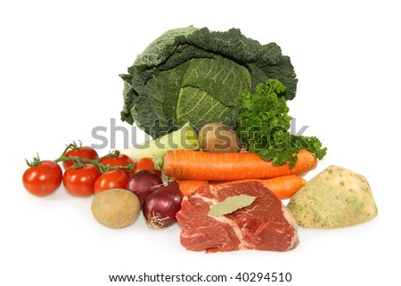 Raw beef meat and vegetables on bright  background - stock photo