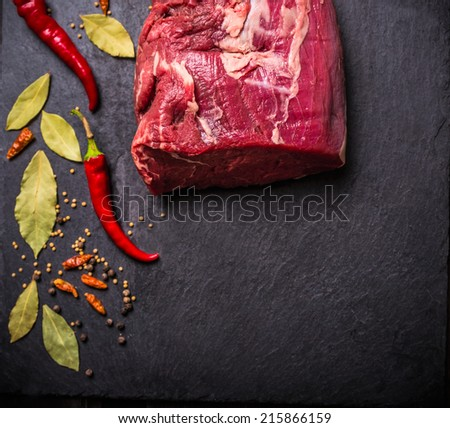 raw Beef meat  fillet with spices on black slate, food background,top view - stock photo